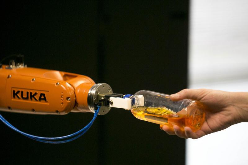 Helmuth Radrich prepares a KUKA Robotics robot for a test in North Austin.