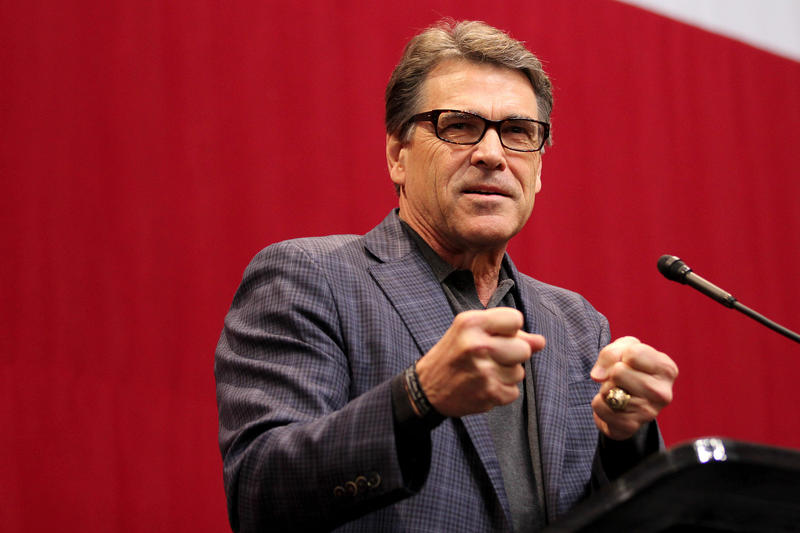 Former Gov. Rick Perry speaks at election night party for Greg Abbott in 2014. On Wednesday, a memo revealed that Perry will be joining President Trump's National Security Council.