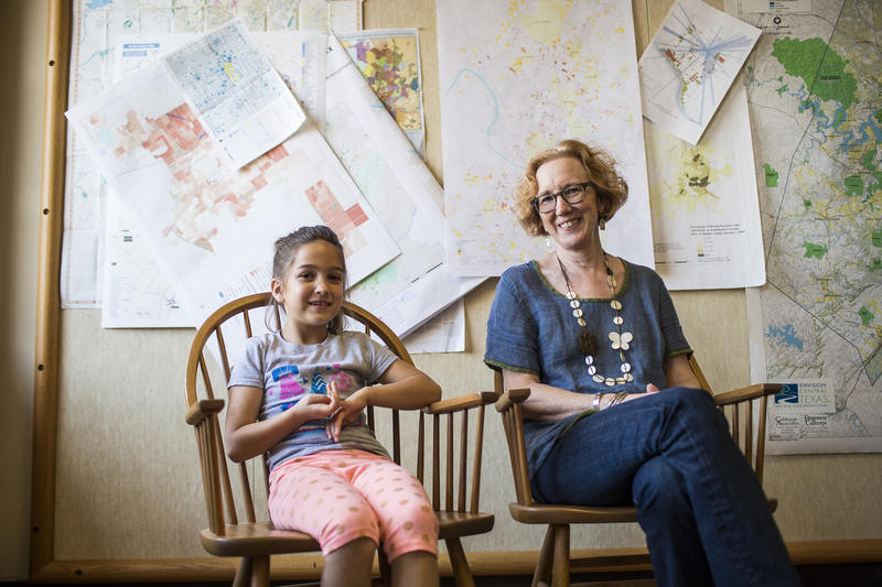 Violet Maas, 6, and Elizabeth Mueller, associate professor of community and regional planning, at Mueller's office on Friday.