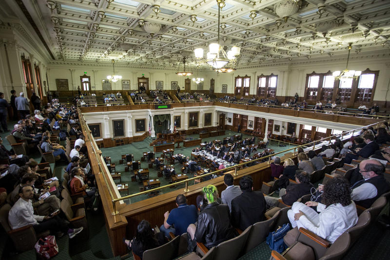 An audience sits in the balcony as Texas lawmakers hear public testimony on Senate Bill 4 in February.