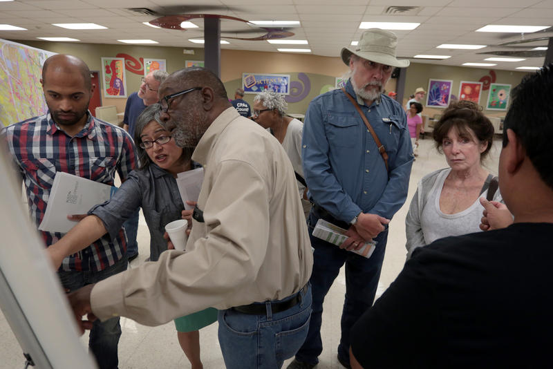 District 1 residents examine the new CodeNEXT maps at an informational open house at Lyndon Baines Johnson Early College High School on Saturday.