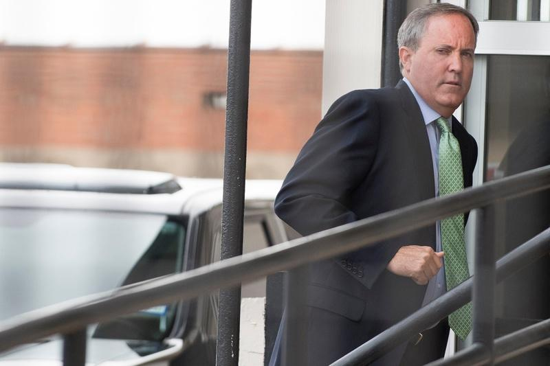 Texas Attorney General Ken Paxton enters a federal courthouse in Sherman last year.