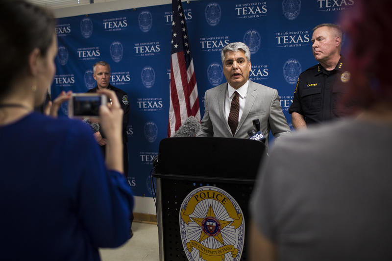Austin Police Chief Brian Manley (left), UT-Austin President Greg Fenves and UTPD Chief David Carter address reporters at a press conference shortly after the stabbing incident on UT campus.