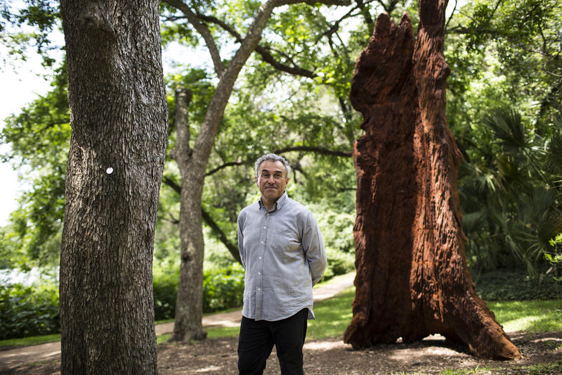 Louis Grachos, director of the Contemporary Austin, says the museum wants to share its collection with the community.  At right is Iron Tree Trunk, a sculpture by Chinese artist Ai Weiwei.