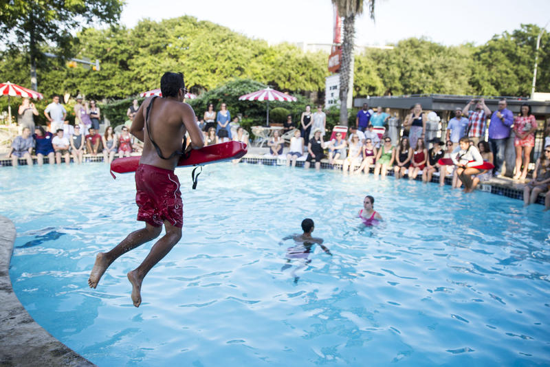 "Adrian Ortega, Rafael Garcia and Sarafina Gabris-Green, with the Austin Parks Department, perform a water rescue as part of a preview to ""My Park, My Pool, My City"" dance."