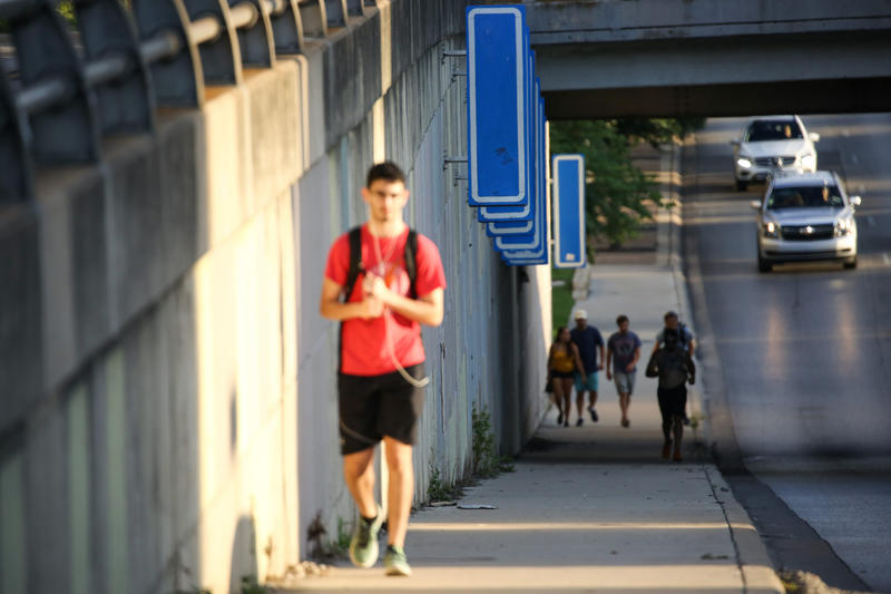 The blue signs at the Lamar underpass near Fifth Street.