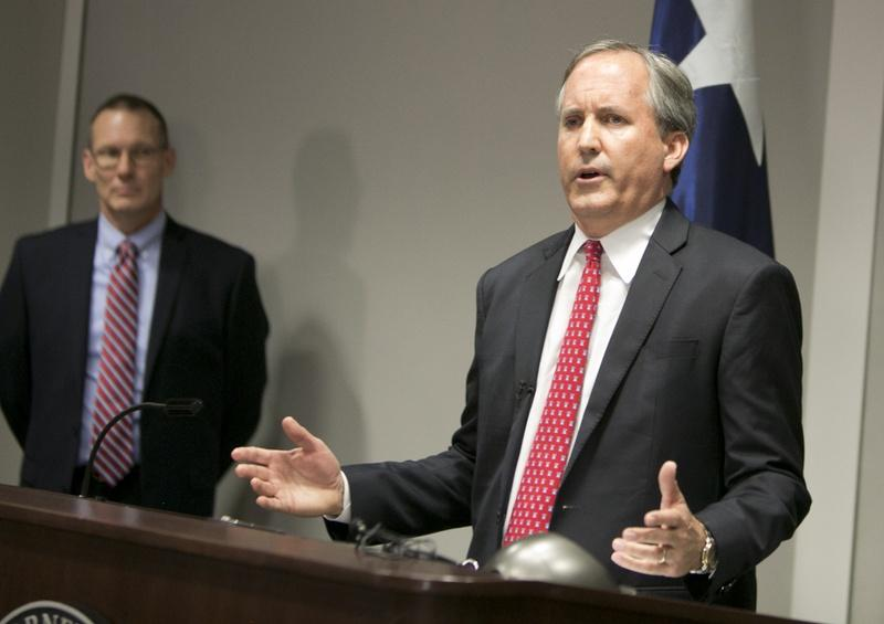 Texas Attorney General Ken Paxton speaks during a news conference last year, announcing a lawsuit filed against the federal government over rules for transgender bathrooms in public schools.