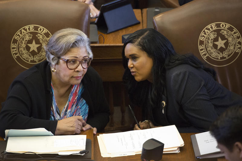 Rep. Senfronia Thompson confers with Rep. Shawn Tierry on the first day of the special session. Thierry sponsored one of four bills the House gave initial approval to Monday aimed at tackling the state's maternal mortality crisis.