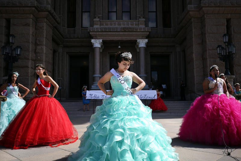 Jennifer Ramirez and 14 other young women wearing quinceañera dresses protest the new sanctuary cities ban on the south steps of the Texas state Capitol on Wednesday.