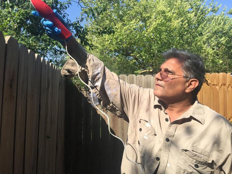 A man sprays for mosquitos in his Brownsville backyard after news of locally acquired Zika cases in Cameron County in 2016.