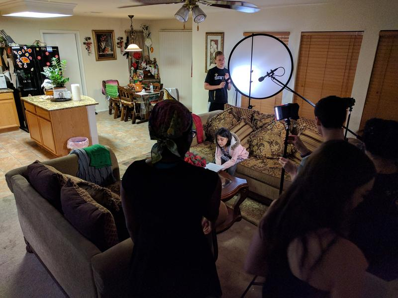 "Members of the Creative Action Youth Cinema Collective shoot a scene from their film, ""I Am Here."" Clockwise from bottom left: Maya Jackson, 16; Myles Kovalik, 16; Julia Villanueva, 11; and Andrew Bacon, 16."