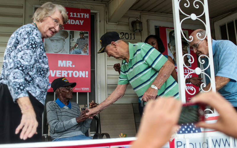 Richard Overton greets well-wishers on his porch in East Austin during a birthday celebration for him in May.