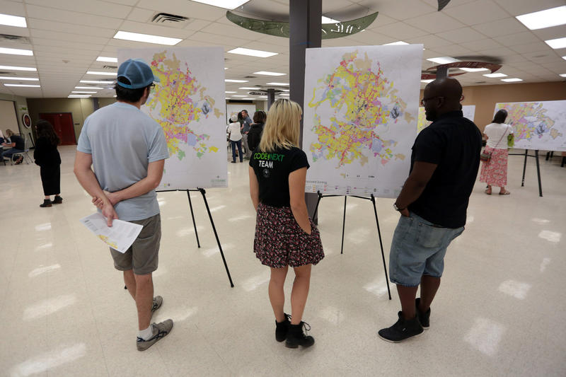 Residents examine CodeNEXT maps at an informational open house hosted by the city in May.