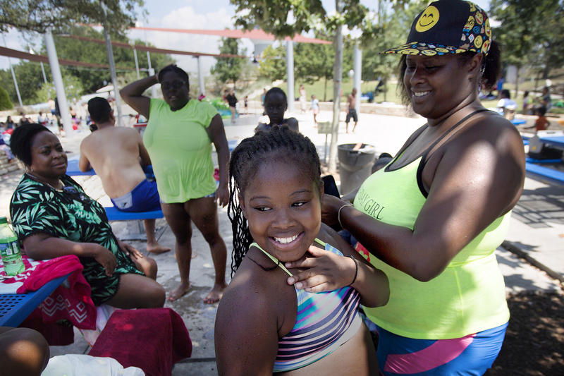 Janiyah Johnson celebrates her ninth birthday with her mother, Denise McClain, and friends at Bartholomew Pool in Northeast Austin last month.