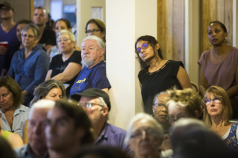 Residents listen to Mayor Steve Adler and others talk about CodeNEXT at a packed meeting of the Bouldin Creek Neighborhood Association on Tuesday.