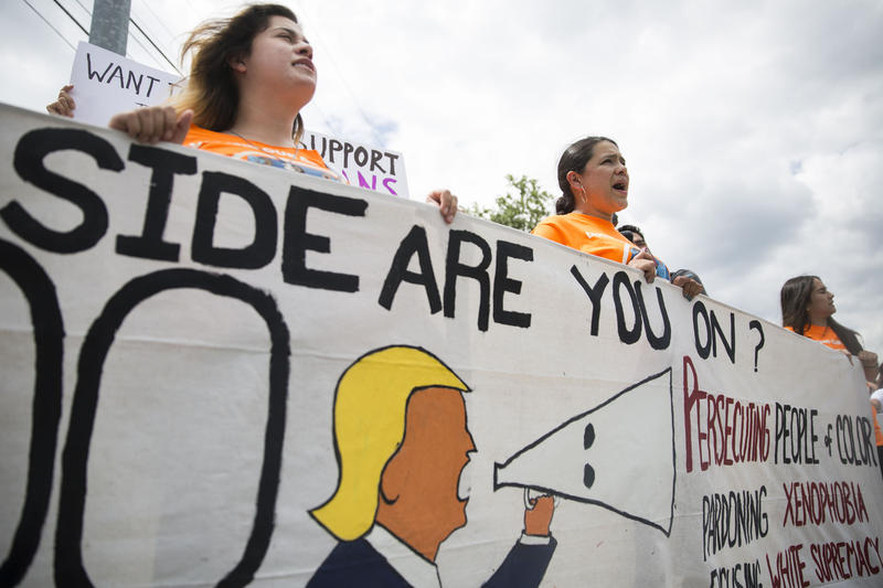 Demonstrators call on President Trump not to end the Deferred Action for Childhood Arrivals, or DACA, program, outside the Department of Public Safety on Aug. 29.