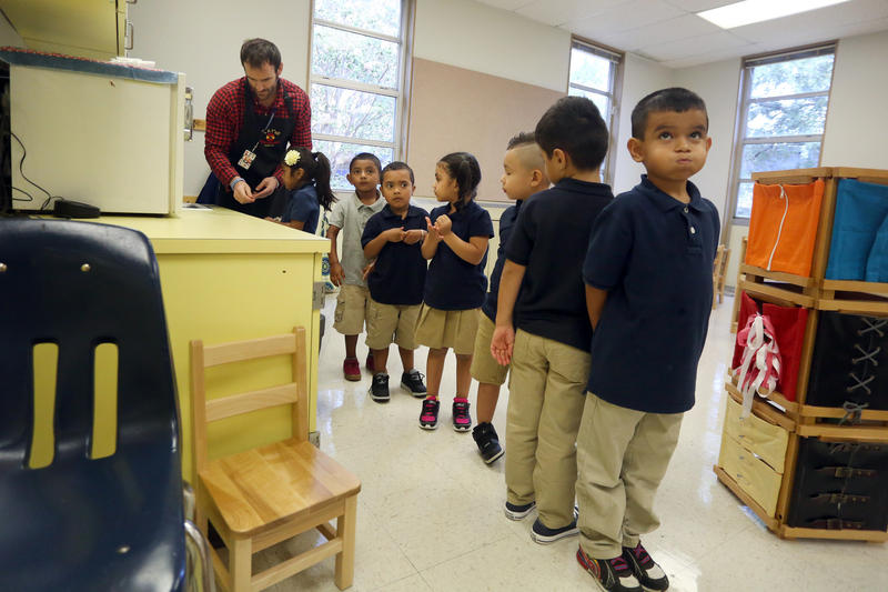 "A student holds a ""quiet bubble"" as Alberto Martinez Miranda's class lines up for lunch at Winn Elementary on Tuesday."