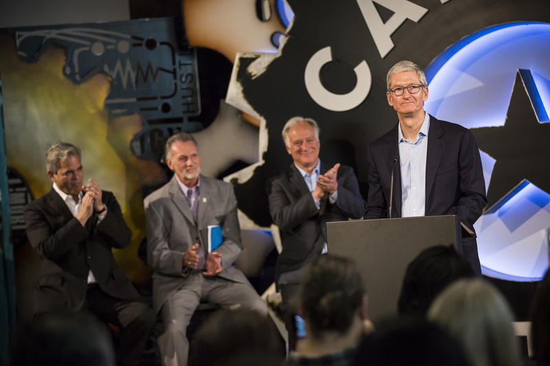 Apple CEO Tim Cook announces an app-programming partnership with Austin Community College at Capital Factory on Friday. Mayor Steve Adler, ACC President Richard Rhodes and Texas Sen. Kirk Watson look on.