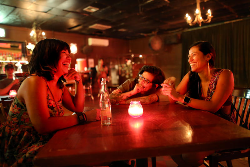 Claudia Aparicio Gamundi, Jessenia Giron and Jennifer Rother, members of the Chulita Vinyl Club, share a laugh at The White Horse on Sunday.