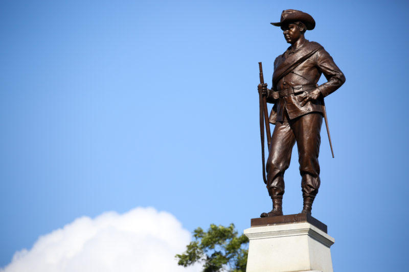 Hood's Texas Brigade Monument at the east end of the Texas state Capitol. The monument features a Confederate soldier, quotes by Confederate leaders, a flag of the Confederacy and the Confederate battle flag.