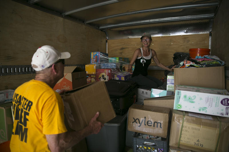 John Black and Lisa Cricket load donated goods for families affected by Harvey into a truck at the Hope Family Thrift Store.