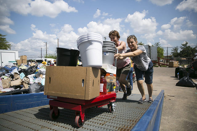 Jill Farmer and Suzanne Saxman push a load of donated goods into the Hope Family Thrift Store. Staff and volunteers at the store received thousands of donated goods from the Austin community for those affected by Harvey.