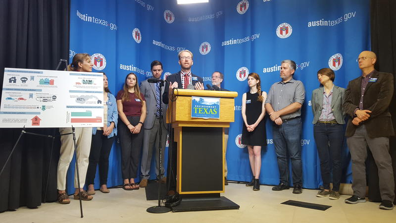 Luke Metzger, director of Environment Texas, speaks at a press conference at Austin City Hall on Monday.