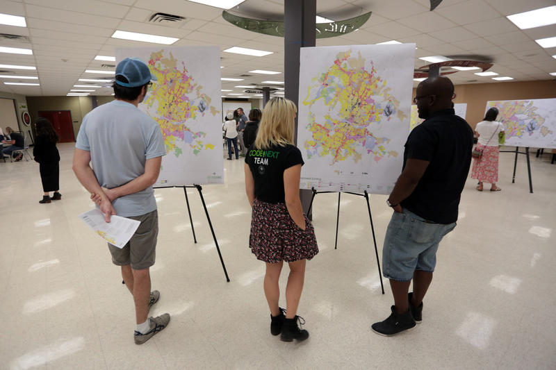 Austinites examine CodeNEXT maps at an open house held in May at Lyndon Baines Johnson Early College High School.