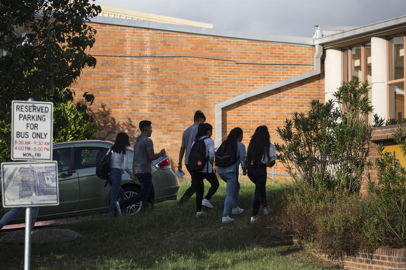 Students walk to William B. Travis High School in South Austin on the first day of the 2017-2018 school year.