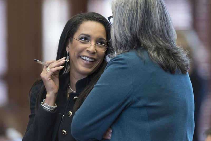 State Rep. Dawnna Dukes, D-Austin, has a laugh with state Rep. Jessica Farrar, D-Houston, during debate on the budget in April.