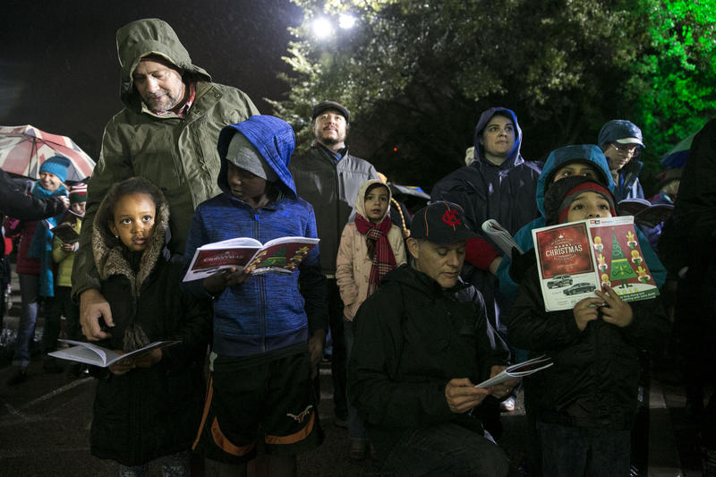 Carolers at the 2016 Sing-Along and Downtown Stroll braved wet weather.