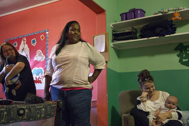 Jacqueline James looks over at infants playing in the only building in her child care center that did not suffer severe damage from Hurricane Harvey.