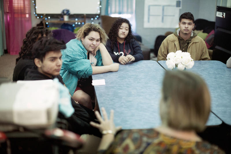 Jennifer Stayton talks with students at Reagan Early College High School about the state of journalism today.