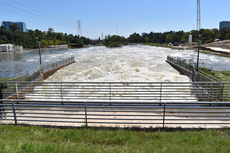 The water rushing out of the Addicks Reservoir during controlled release after Harvey.