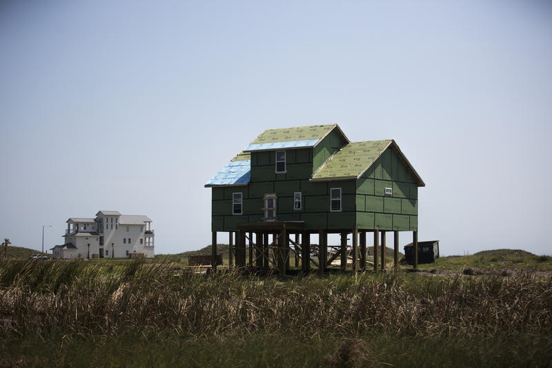 A house in Port Aransas gets a new roof and siding on Sept. 30, about a month after Hurricane Harvey hit.