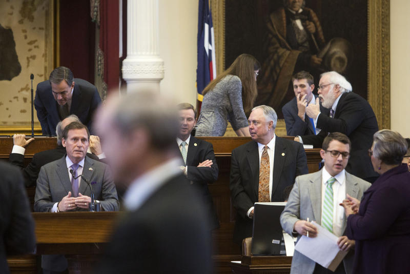 Texas House representatives confer in March during the 85th legislative session.