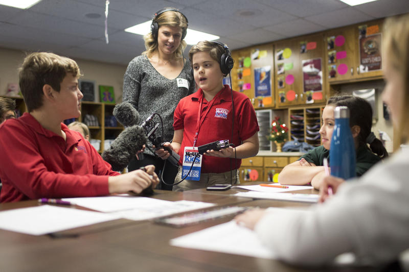 Truman Hamade, 10, interviews classmate Kyle Lowther at Redeemer Lutheran School after getting a lesson from education reporter Claire McInerny.