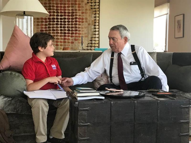 Truman Hamade, 10, interviews journalist Dan Rather.
