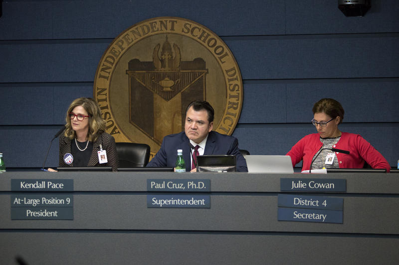 AISD Superintendent Paul Cruz and school board members Kendall Pace and Julie Cowan listen to arguments over renaming Austin schools named for Confederate figures.