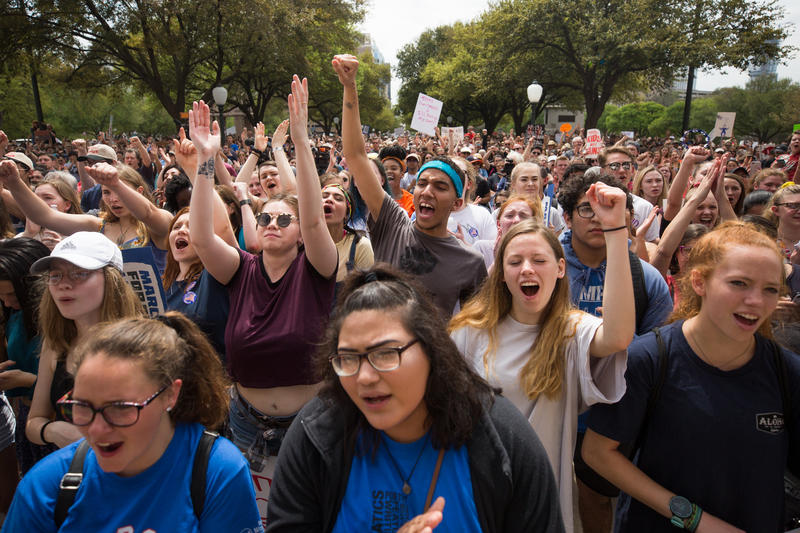 Thousands of people march from Austin City Hall to the Texas State Capitol to raise awareness and evoke change in Texas and U.S. gun policies.