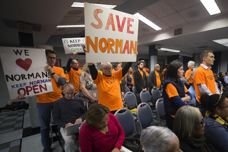 Supporters of Norman Elementary School showed up to support keeping the school open during a meeting of the AISD Board of Trustees meeting on Feb. 26.