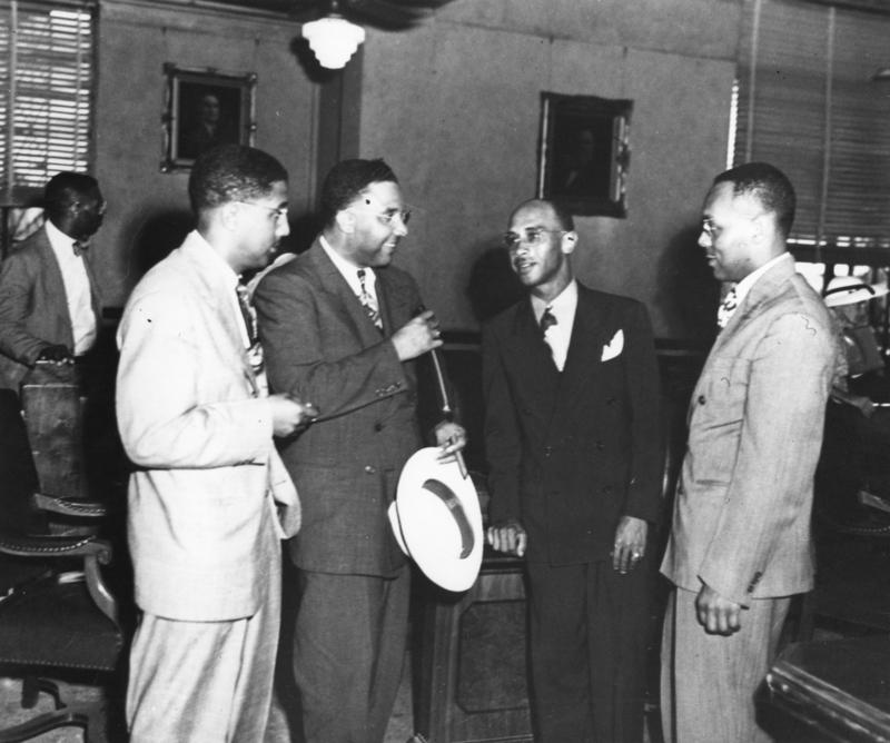 Heman Marion Sweatt (third from left) discusses his lawsuit against UT with members of the NAACP legal team.