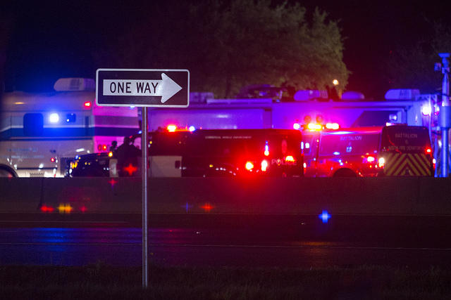 Law enforcement and media gather on Interstate 35 in Round Rock, Texas near the scene of a vehicle explosion that killed Austin serial bombing suspect Mark Anthony Conditt on March 21, 2018.