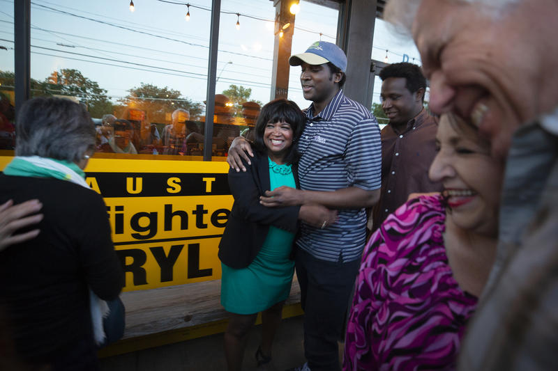 Sheryl Cole greets supporters at an election night watch party at Hoover's in East Austin on Tuesday.