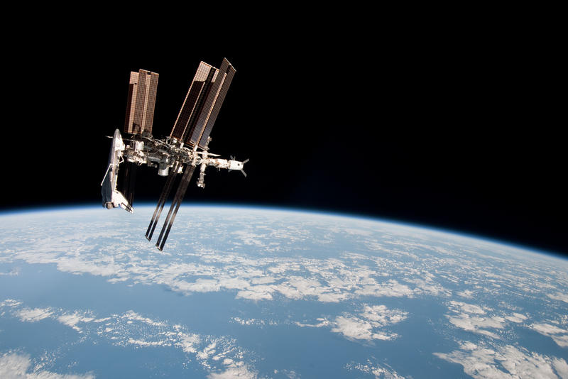 The International Space Station and the docked space shuttle Endeavour, flying at an altitude of approximately 220 miles