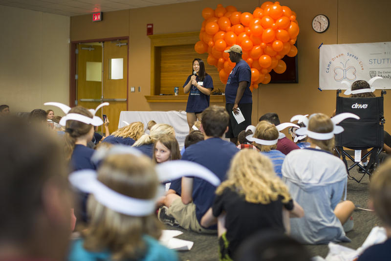 Camp counselor Diana Tran speaks during an open mic at Camp Dream. Speak. Live.