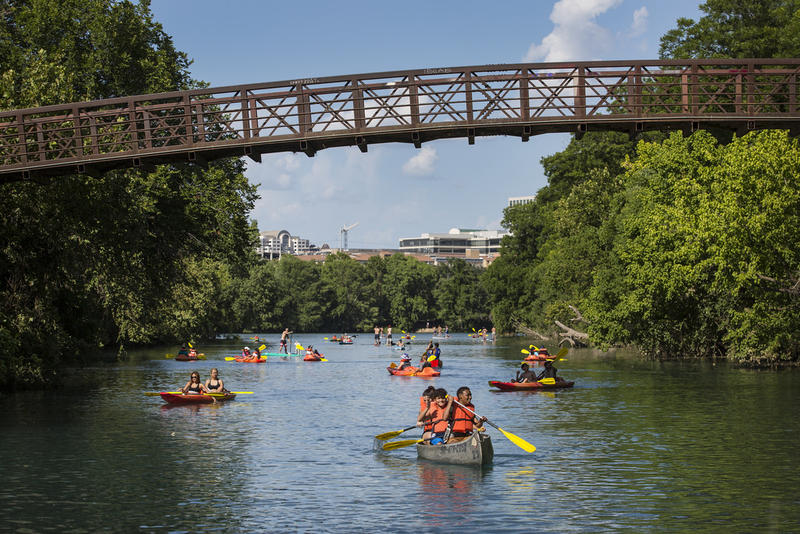 You can canoe and you can paddleboard, but you just can't swim in Lady Bird Lake.