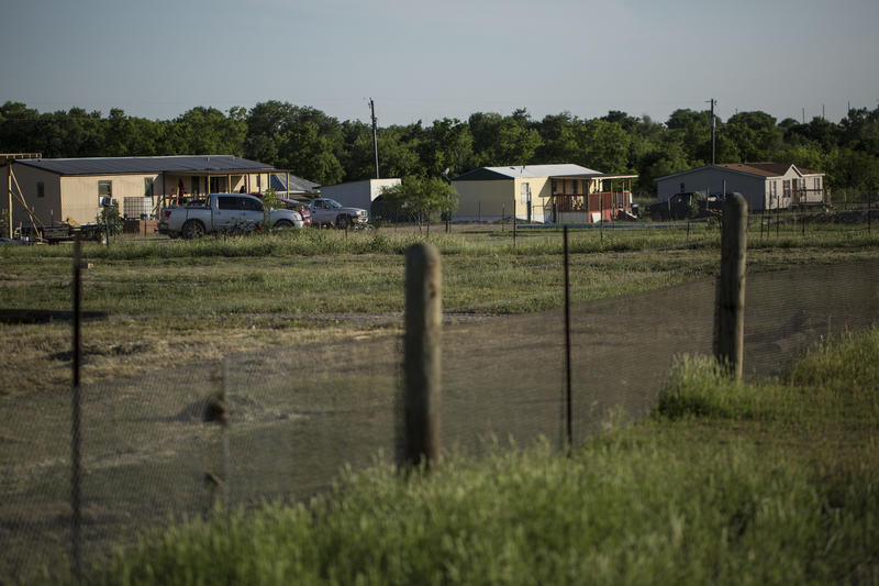 After being forced to leave a mobile home park in East Austin, the Torres family rented land about 40 minutes outside the city in Del Valle.