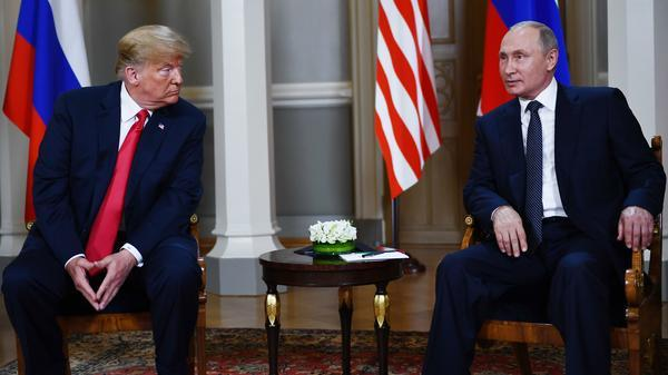 Russian President Vladimir Putin and President Trump pose ahead a meeting in Helsinki, on Monday. Trump is under pressure to confront Putin about the indictment of 12 Russians accused of conspiring to interfere in the 2016 election.