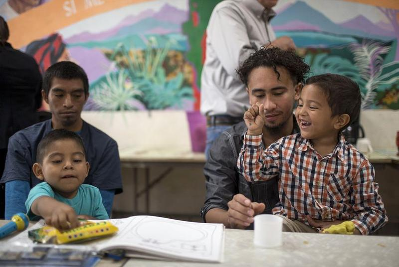 Pablo Ortiz and his 3-year-old son Andres and Roger and his 4-year-old Roger Jr., speak to the media during a press conference at the Annunciation House immigrant shelter in El Paso in July 2018 after being released by ICE.